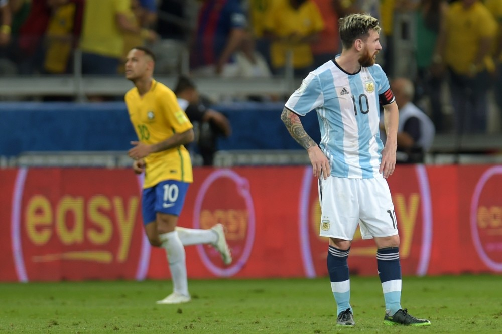 Argentinau2019s Lionel Messi stands in dejection after Brazilu2019s Neymar scored the teamu2019s second goal during their 2018 FIFA World Cup qualifier football match in Belo Horizonte.
