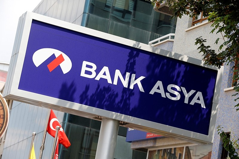 A Bank Asya logo is seen at a branch in Ankara August 12, 2014. (REUTERS Photo)