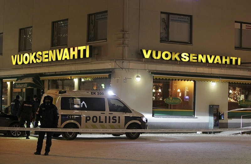 Police guards the area were three people were killed in a shooting incident at a restaurant in Imatra, Eastern Finland after midnight on December 4, 2016. (Reuters Photo)