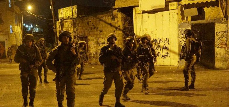 ISRAELI FORCES ARREST DOZENS OF PALESTINIANS IN WEST BANK RAIDS