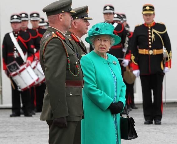 Queen Elizabeth II looks back at Irish Defence Guard Chief of Staff, Lt. Gen. Sean McCann, at the Aras an Uachtarain, in Dublin, 2011.
