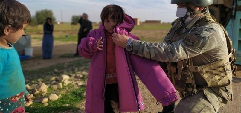 TURKISH SOLDIERS DISTRIBUTE AID IN NORTHERN SYRIA