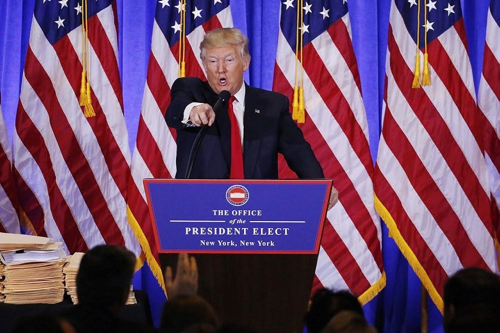 U.S. President-elect Donald Trump argues with CNN's Jim Acosta during a news conference in the lobby of Trump Tower in Manhattan, New York City, U.S., January 11, 2017. (REUTERS Photo)