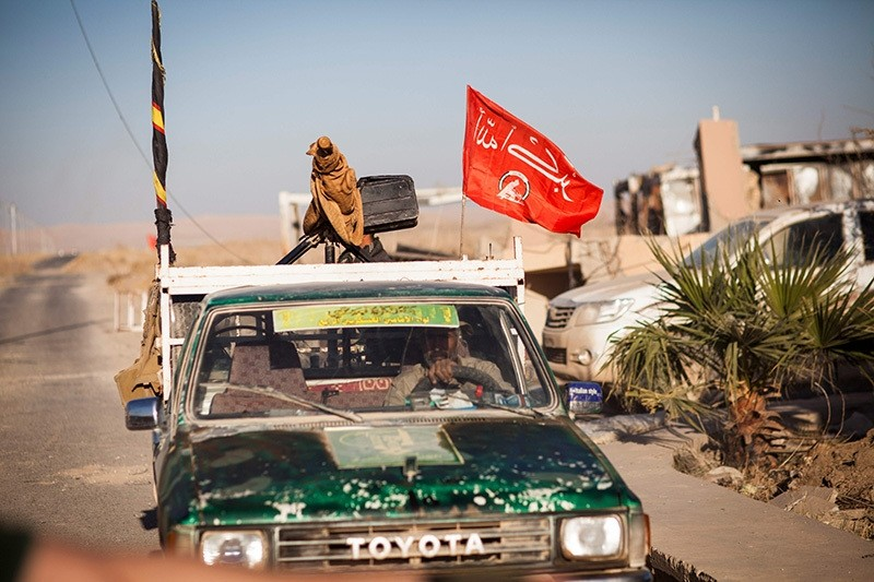 A soldier of the Hashd Al Shaabi (Popular Mobilisation Units) drives a pickup truck as he arrives at Tal Afar airport on November 20, 2016. (AFP Photo)