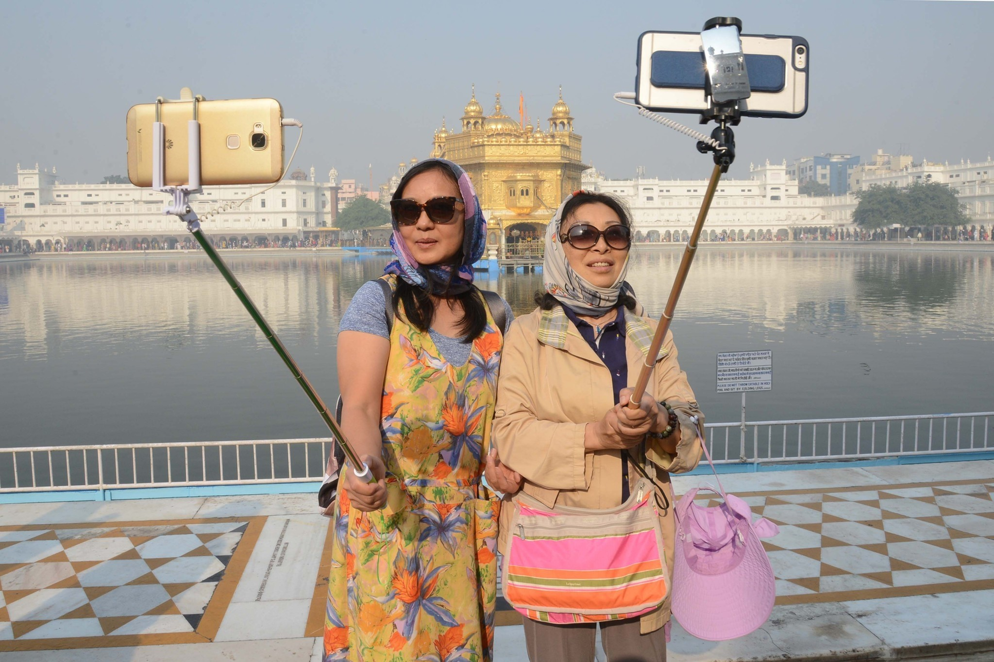 Chinese tourists take a 'selfie' at the Golden Temple in Amritsar on November 14, 2016, as Sikh devotees mark the 547th birth anniversary of Sri Guru Nanak Dev. (AFP Photo)