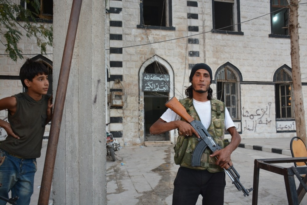 A Free Syrian Army fighter poses in the main square of the northern Syrian town of Jarablus.