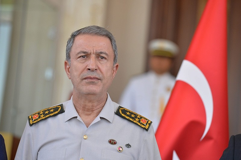 Chief of Staff Akar, with clear bruises on his neck resulted from scuffles with coup plotting soldiers, is seen on July 17 in Ankara during his first appearance following the coup attempt. (Photo: Sabah / Ali Ekeyu0131lmaz)
