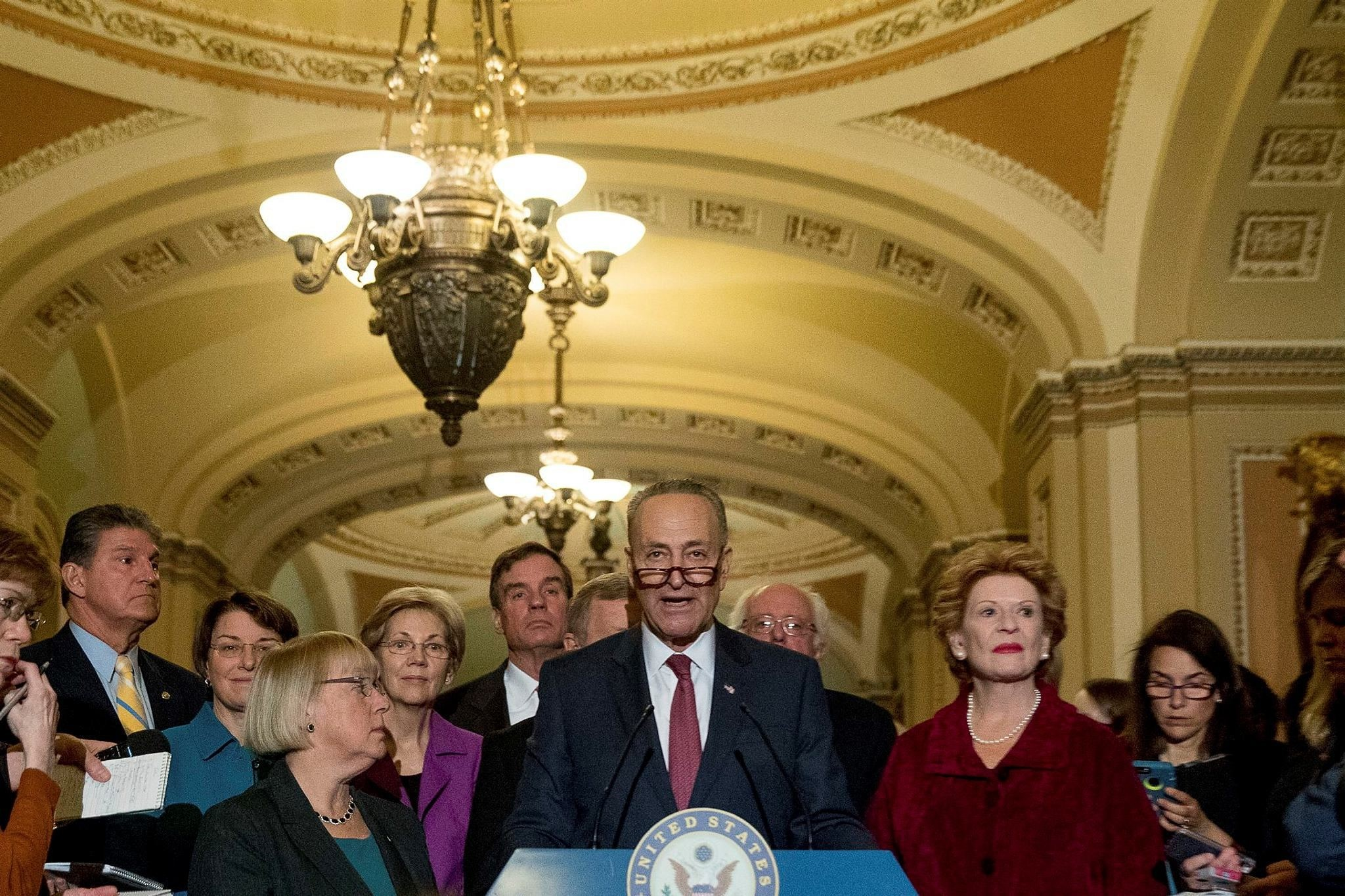 Sen. Chuck Schumer, D-N.Y., center, accompanied by the Senate Democrats, speaks to reporters on Capitol Hill in Washington, Wednesday, Nov. 16, 2016. (AP Photo)