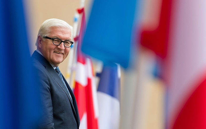 German Foreign Minister Frank-Walter Steinmeier smiles as he stands next to flags on Nov. 8, 2016. (AFP Photo)