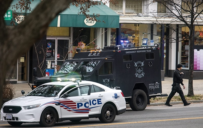 Police surround Comet Ping Pong, a pizza restaurant that was the subject of claims it was the center of a child sex ring orchestrated by Hillary Clinton and her campaign chief, John Podesta (EPA Photo)