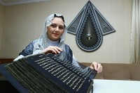 Azerbaijani painter and decorative artist Tünzale Memmedzade has transcribed the Quran onto transparent silk pages.  Memmedzade, a 33-year-old artist, used 50 meters of transparent black silk,...