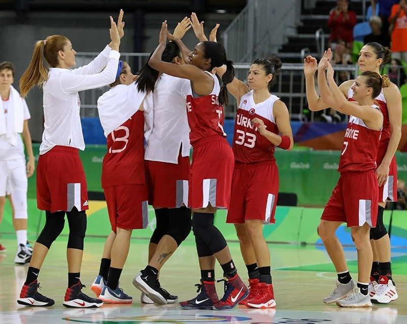 Players of Turkey celebrate their win at the end of the women's preliminary round Group A match between Belarus and Turkey for the Rio 2016 Olympic Games at the Youth Arena in Deodoro, Rio de Janeiro, Brazil, Aug 11, 2016. (EPA Photo)