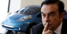 Ex-Nissan chief charged, served with fresh arrest warrant