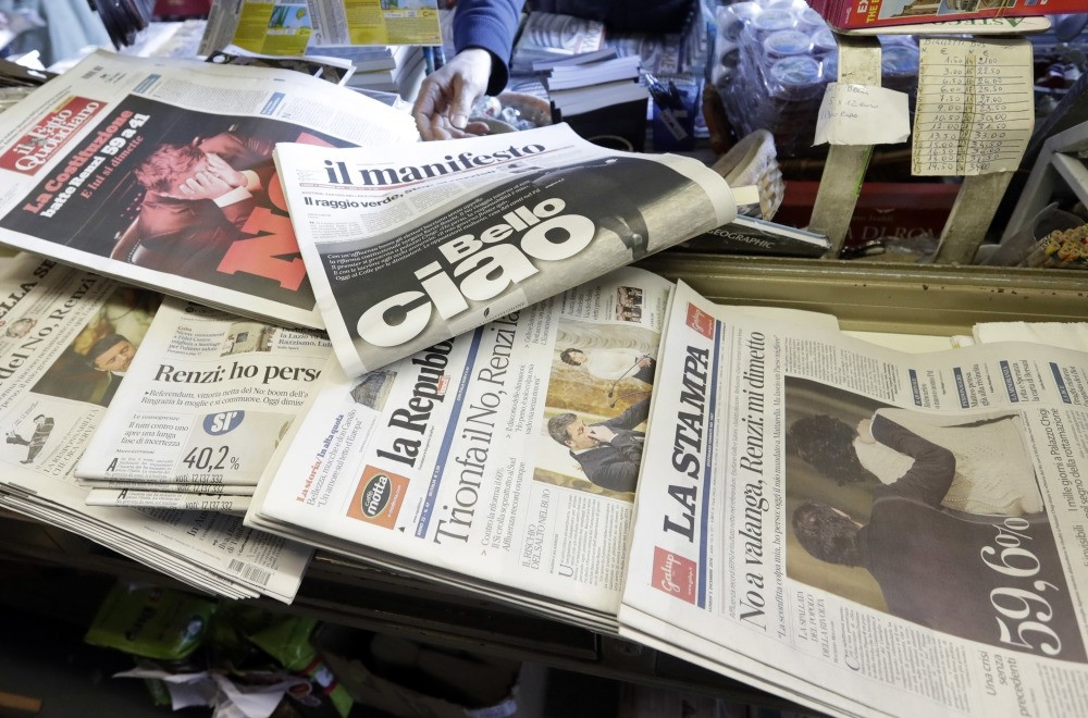 Newspaper headlines showing Italian Premier Matteo Renzi's resignation following the result of Sunday's constitutional referendum, at a newsstand in Rome, Dec. 5, 2016.