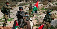Israeli forces filmed in 'bloody entertainment'