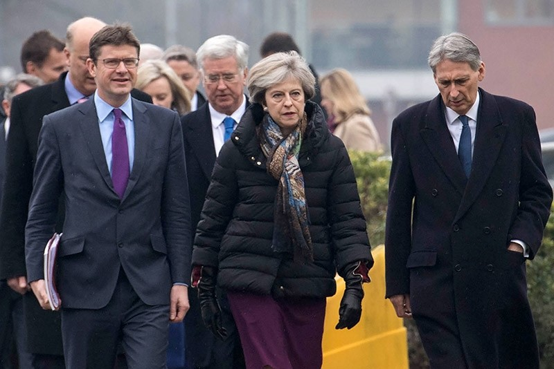 British Prime Minister Theresa May (C) arrives with colleagues to hold a regional Cabinet meeting in Runcorn, north west England on Jan. 23, 2017. (AFP Photo)