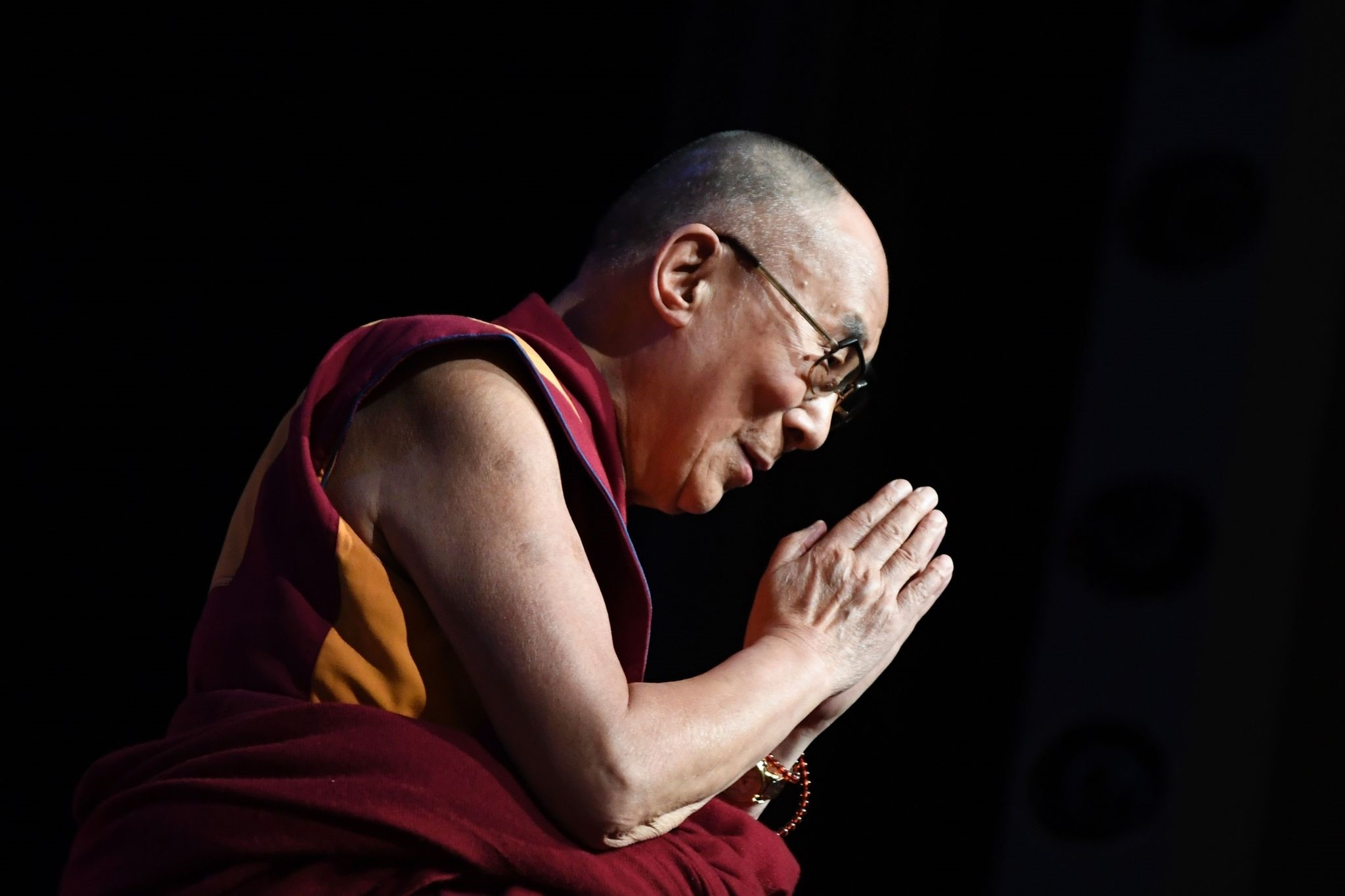 The Dalai Lama gestures during a group hearing at the Palais des Congres, on September 13, 2016 in Paris, during his visit to France. (AFP PHOTO)