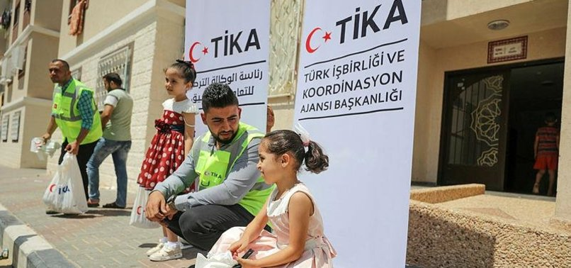 TURKISH VOLUNTEERS DISTRIBUTE EID MEAT TO GAZA FAMILIES