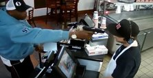 Cashier unfazed by gunman