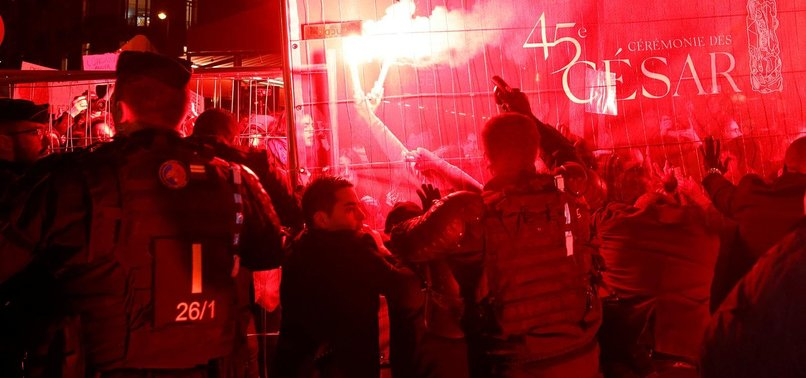 FRENCH POLICE FIRE TEAR GAS IN CLASH WITH ANTI-POLANSKI PROTESTERS
