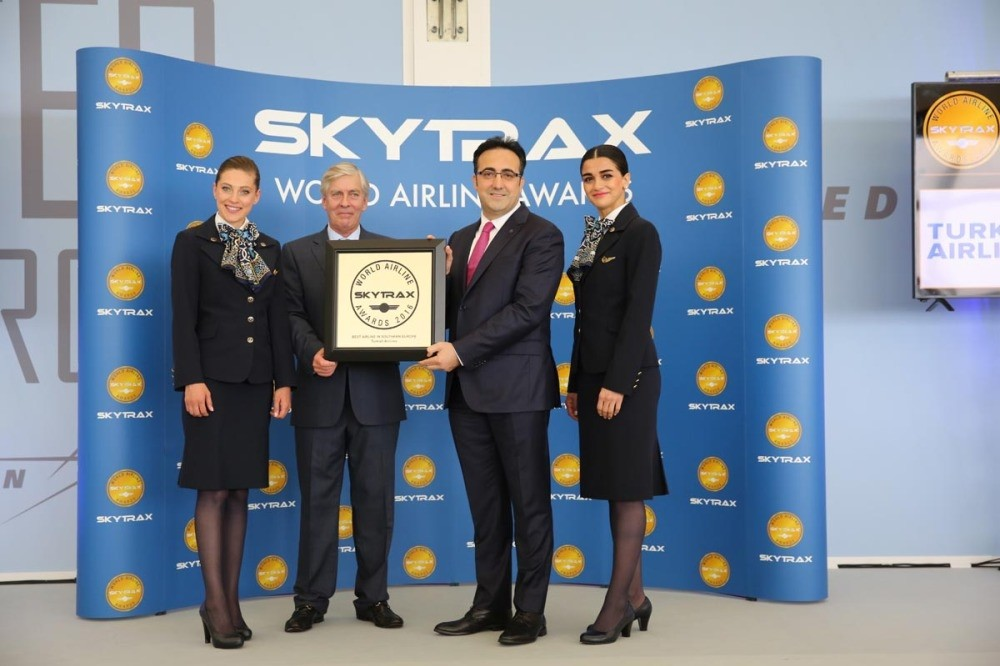 THY Chairman of the Board and the Executive Committee u0130lker Aycu0131 receives the award from Skytrax CEO Edward Plaisted (L) at Tuesdayu2019s ceremony.