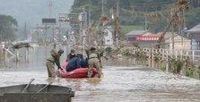 Floods batter Japan as virus cases surge in Tokyo