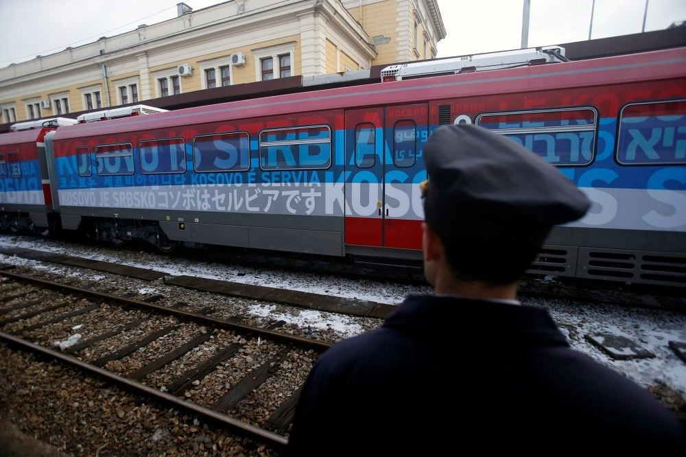 A railroad worker stands by the first train decorated with letters that read u201cKosovo is Serbianu201d written in twenty languages departing from the Belgrade to Mitrovica, Kosovo at Belgradeu2019s railway station, Serbia, Jan. 14.