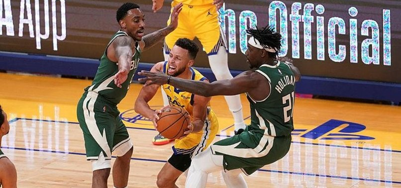 STEPHEN CURRY POURS IN 41 AS WARRIORS RALLY PAST BUCKS