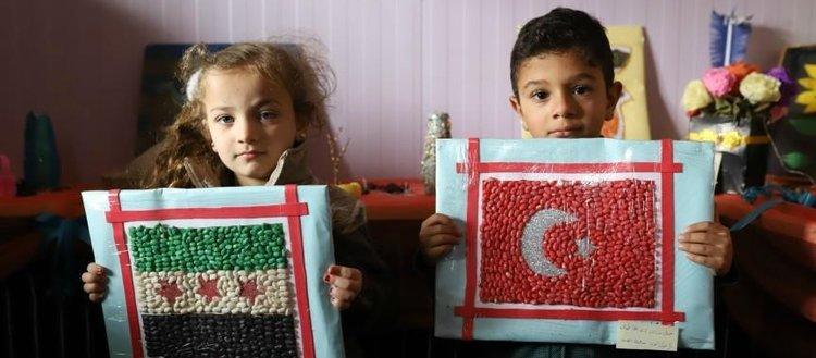 Suriye'deki yetim çocuklardan resim ve oyuncak sergisi