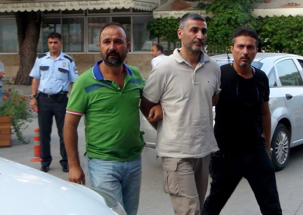 Police officers accompany Gu00f6khan Su00f6nmezateu015f to a courthouse in the southwestern city of Muu011fla where he was transferred after his capture in Ankara.