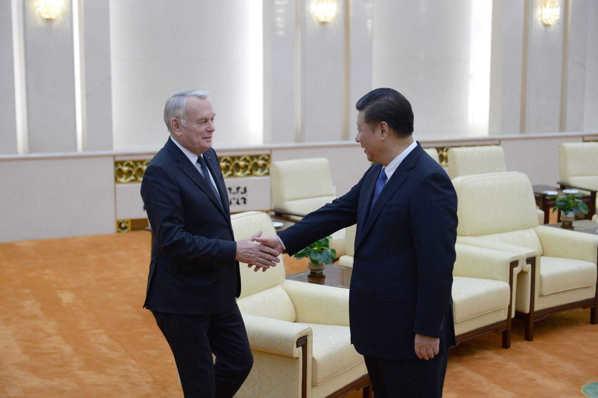 Chinese President Xi Jinping (R) shakes hands with French Foreign Minister Jean-Marc Ayrault ahead of their meeting at the Great Hall of the People in Beijing. The French foreign minister is on an official visit to China.