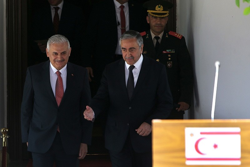 Turkish Prime Minister Binali Yu0131ldu0131ru0131m (L) and Turkish Cypriot leader Mustafa Aku0131ncu0131 leave their meeting following a press conference. (AP Photo)