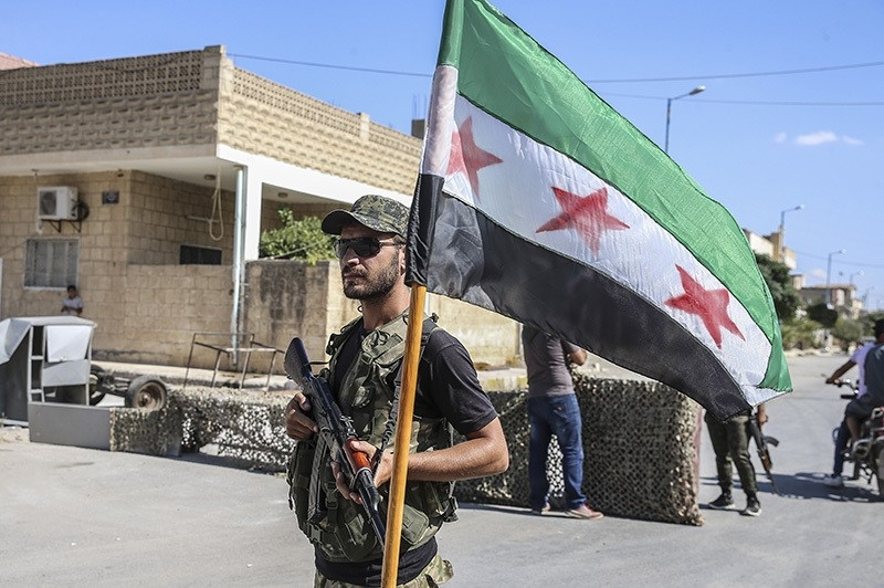 A Free Syrian Army fighter seen at a checkpoint in northern Syrian town of Jarablus, Sept. 16, 2016. (AA Photo)