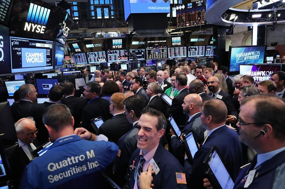 Traders work on the floor of the New York Stock Exchange. Disappointing growth in the worldu2019s largest economy might make it less likely the U.S. Federal Reserve to raise interest rates in December.