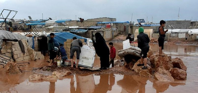 AFTER RAINS, 32,000 AWAIT AID ALONG SYRIAN BORDER