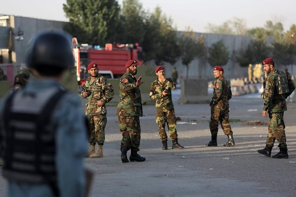 Afghan soldiers and police inspects the site of suicide attack In Kabul near Afghanistan's Defense Ministry, Monday, Sept. 5, 2016. (AP Photo)