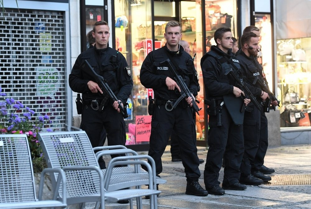 Police secure a hotel after a shooting was reported in Munich, July 22.