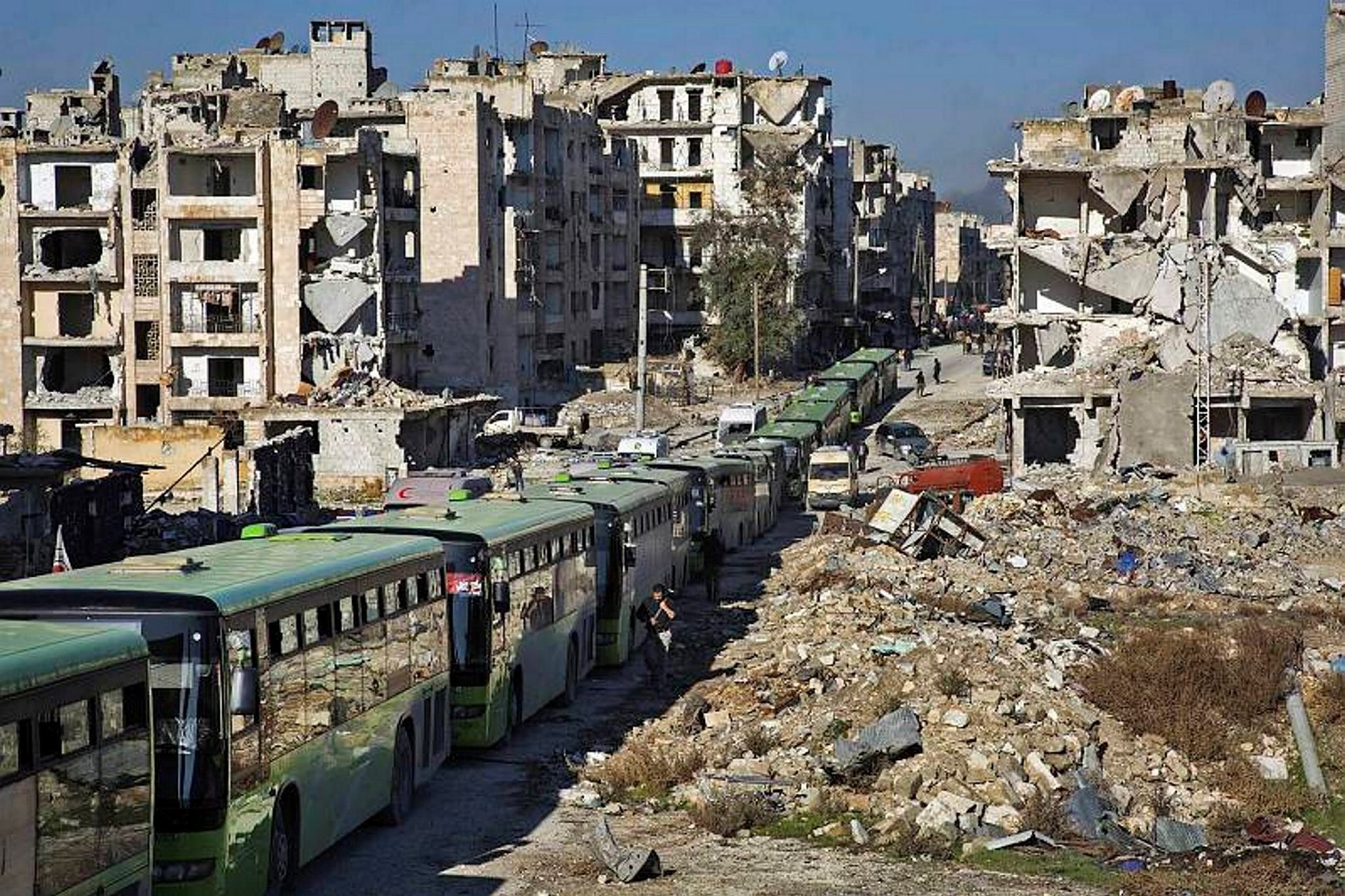 Buses are seen during an evacuation operation of opposition fighters and their families from opposition-held neighbourhoods in the embattled city of Aleppo, Dec. 15