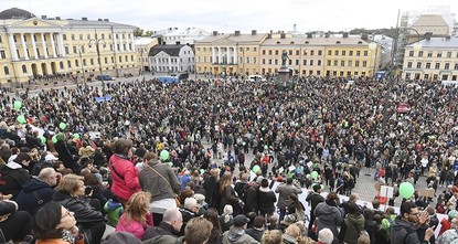 pAround 15,000 people marched in central Helsinki Saturday to protest against rising racism and violent right-wing extremism, police said, following the recent death of a man allegedly attacked by...