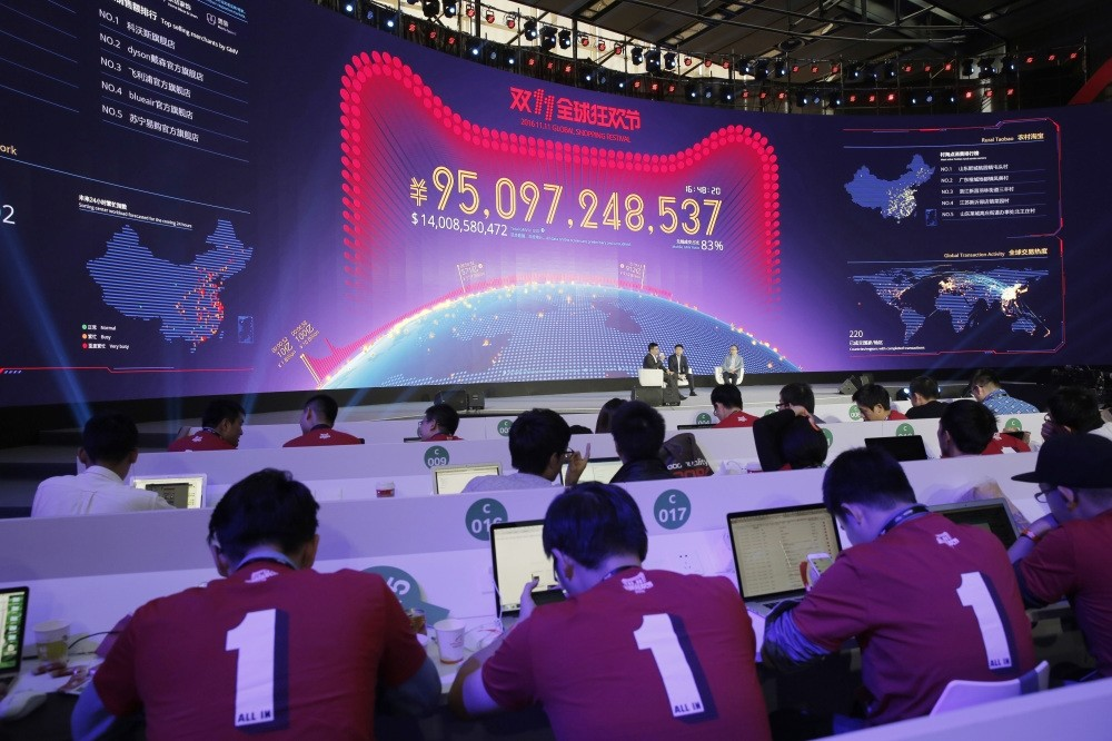 A giant screen showing total sales transacted by e-commerce giant Alibaba on the u2018Singlesu2019 Dayu2019 global online shopping festival in Shenzhen, southern Chinau2019s Guangdong province.