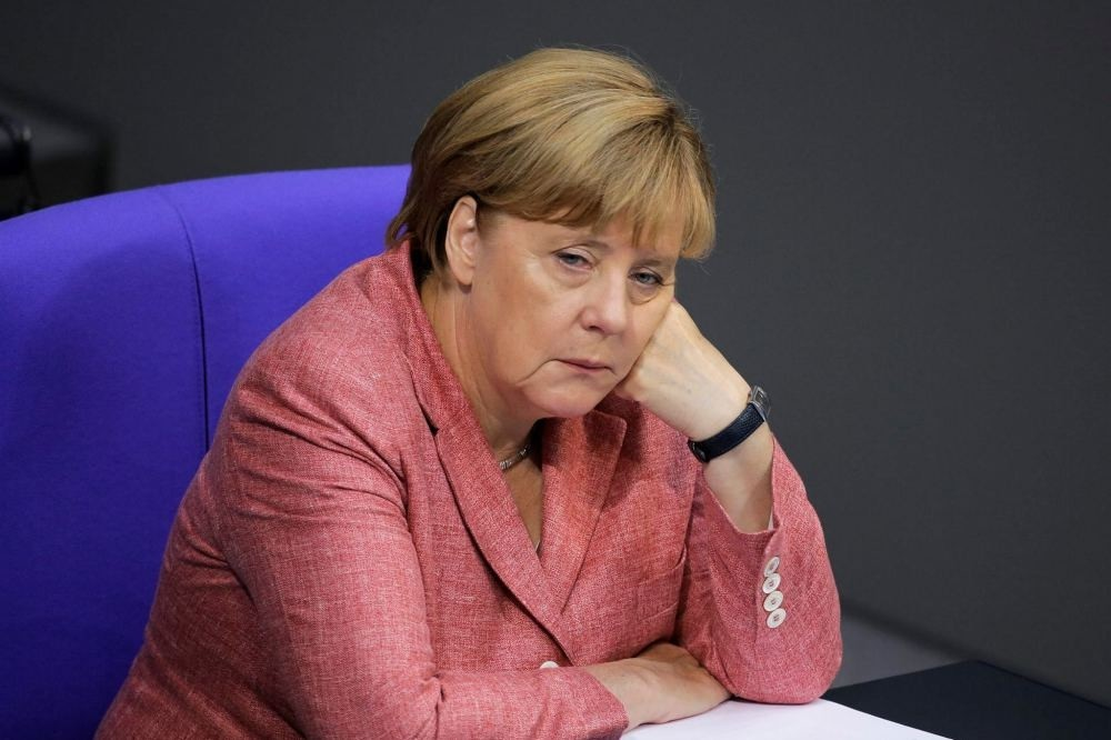 German Chancellor Angela Merkel resting her head as she attended the budget 2017 debate at the Bundestag in Berlin, Sept. 6.