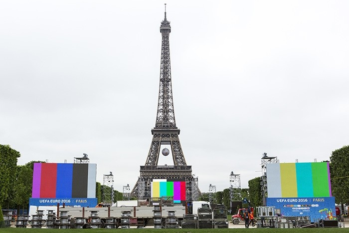 The Euro 2016 Paris Fan Zone is under construction on the Champs de Mars, with a giant screen and the Eiffel Tower on the background, in Paris, France, Friday, June 3, 2016. (AP Photo)