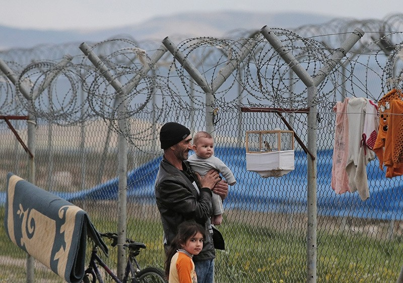File photo of Syrian refugee Abdullah Koca, 43, who fled Syria 4-years ago and has been living at a refugee camp for Syrian refugees in s.eastern Turkey (AP)