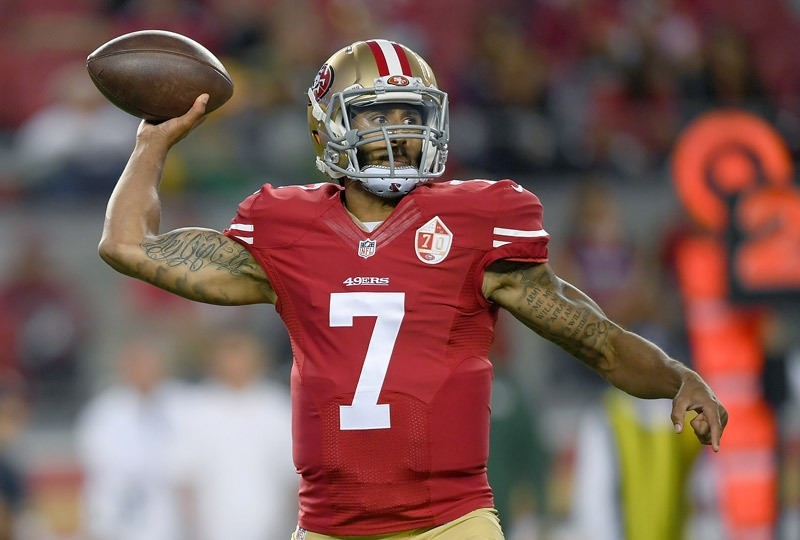 Quarterback Colin Kaepernick of the San Francisco 49ers throws a pass against the Green Bay Packers in the first half of their preseason football game at Levi's Stadium on August 26, 2016 in Santa Clara, California.  AFP Photo