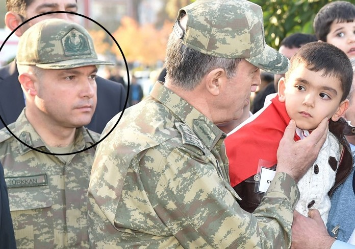 In this file photo, Lt. Cl. Levent Tu00fcrkkan is pictured beside Turkey's Chief of Staff Hulusi Akar
