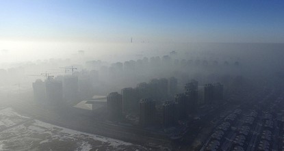 pBeijing and other cities across northern and central China were shrouded in thick smog Monday, prompting authorities to delay dozens of flights and close highways./p