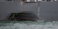 10 US sailors missing after warship collides with tanker