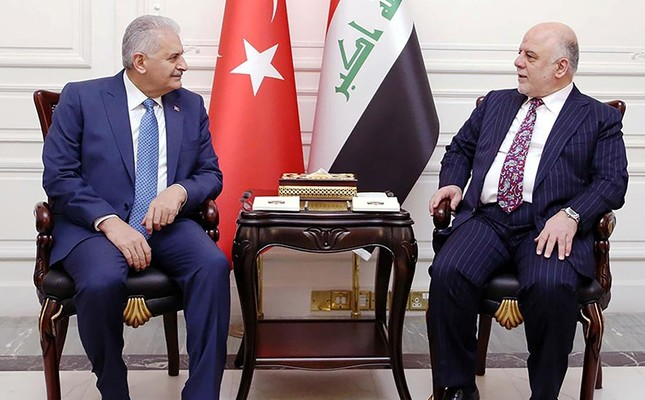 A handout picture released by the Iraq Prime Minister's Press Office on January 7, 2017, shows Iraqi Prime Minister Haidar al-Abadi (R) meeting with his Turkish counterpart Binali Yıldırım in the capital Baghdad. (AFP Photo)