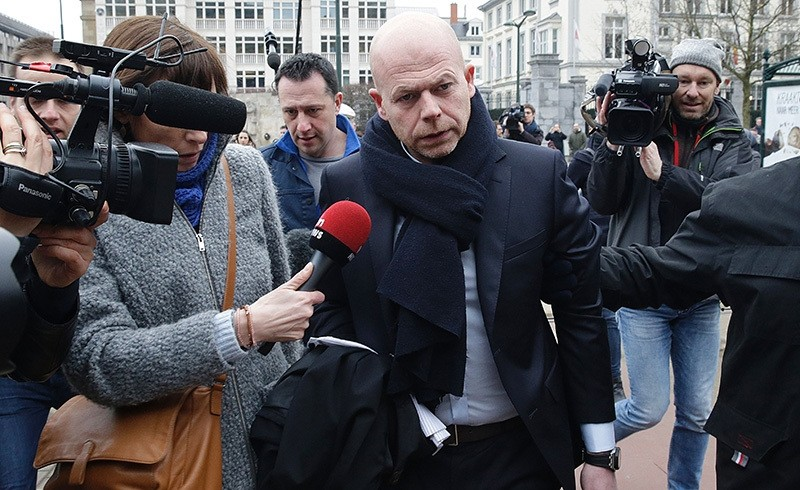 This file photo taken on March 24, 2016 shows Sven Mary (C), lawyer of key suspect in the Paris terror attacks Salah Abdeslam, arriving at the Council Chamber of Brussels (AFP Photo)