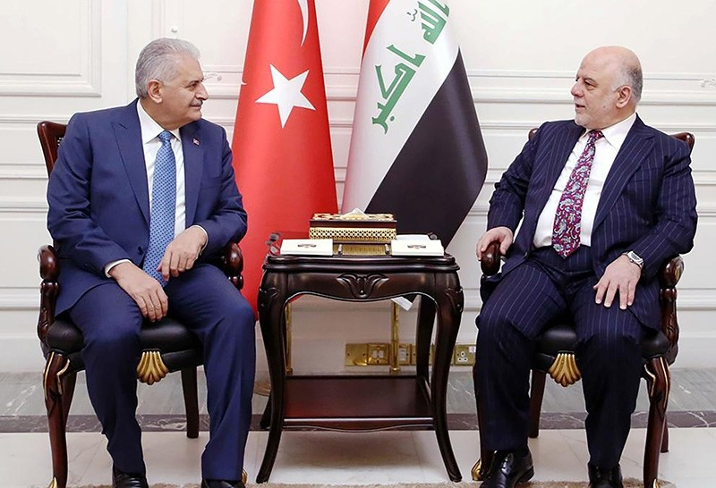 A handout picture released by the Iraq Prime Minister's Press Office on January 7, 2017, shows Iraqi Prime Minister Haidar al-Abadi (R) meeting with his Turkish counterpart Binali Yu0131ldu0131ru0131m in the capital Baghdad. (AFP Photo)